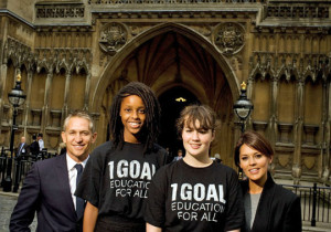 Gary and Danielle Lineker outside the Houses of Parliament with young campaigners wearing 1GOAL tshirts