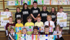 Children in 1GOAL t shirts with artwork.