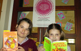 Two girls reading books.