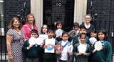 Group of schoolchildren and adults outside 10 Downing Street