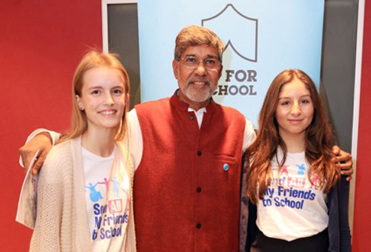 Rebecca Unwin and Maisie Le Masurier with Nobel Prize winner Kailash Satyarthi
